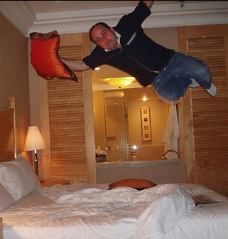 man-jumping-on-a-bed.jpg