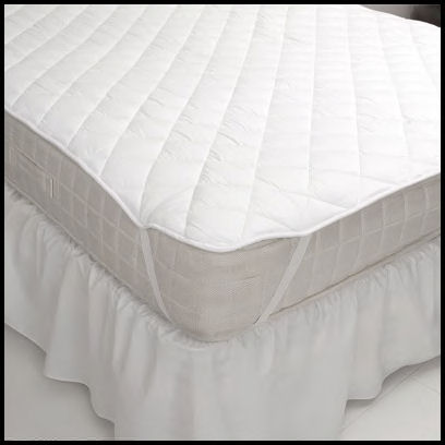 Mattress pad with straps