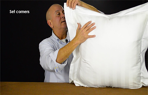 After your pillow insert in placed in the sham set the corners