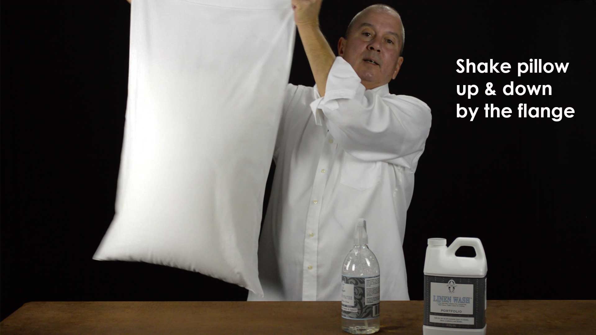A spray bottle of water can remove wrinkles in your bed linens